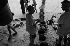 Werner Bischof - Hong Kong. 1952. Water distribution in a refugee center.