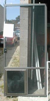 heavy duty pet door in sliding screen door in bronze with custom horizontal crossbar for additional