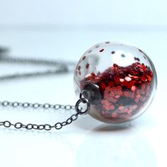 Red glitter necklace in round hand blown glass beads antiqued sterling silver. $34.00, via Etsy.