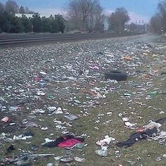 Trash from eastern cities is shipped west by rail for disposal, leading to messes like this, along Rochester's rail corridor. (Photo by Douglas J. Perot)
