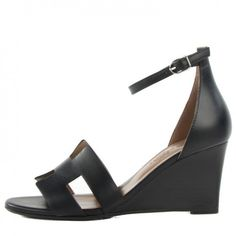 This is an authentic pair of HERMES Calfskin Legend Wedge Sandals 36. 5 in Noir Black.