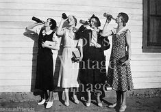 Prohibition: flappers drink bootleg alcohol, 1925 my kind of women.find me a flapper dress I'm going in!