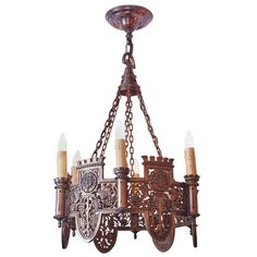Beautifully Detailed Six Light Bronze English Tudor Style Chandelier | From a unique collection of antique and modern chandeliers and pendants  at https://www.1stdibs.com/furniture/lighting/chandeliers-pendant-lights/