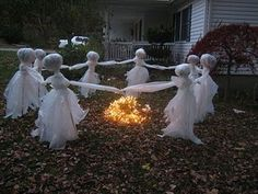 Creepy DIY Halloween Decorations…could make these out of cheese cloth, spray starch, a balloon, wire and a stick. After popping the balloon, placing on a stick and spraying with starch, they will hold there shape then place them in the ground. ; )