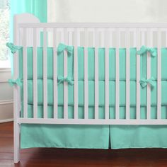 """Solid Teal Crib Bedding by Carousel Designs.  This stunning shade of teal will make your nursery a standout. Its versatility will allow for so many options when decorating your nursery. A """"must have"""" for that special little one in your life."""