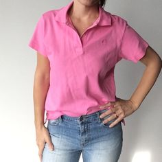 SALELilly Pulitzer 100% cotton pink polo top Lilly Pulitzer 100% cotton pink polo shirt Pre-owned- great condition, no holes or stains. Made of 100% Pima cotton Size Small. Measurements:  Underarm to underarm flat across is approximately 19 inches. Back of neck to bottom of hem is approximately 23 1/2 inches. Lilly Pulitzer Tops