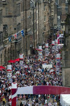 Hundreds of people walking down Royal Mile during Edinburgh Festival