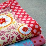 I lurve anything with Anna Maria Horner fabrics, so this caught my eye.  I also love ideas for baby blankets.