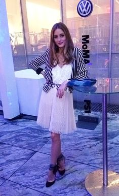 Snapped at the MOMA! My shoes are Aquazzura Madison pumps with a Topshop skirt. The top is from Tibi with a belt and jacket Zara. I added a pop of color with a blue clutch, mine is Miss Dior which is part of Dior's Fall 2012 Collection.