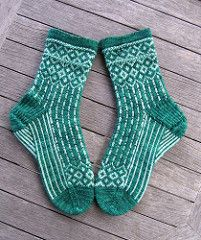 This Game of Thrones inspired pattern was designed for the Sock Knitters Anonymous group for the November 2016 Mystery Sock, or MOCK, to fit the stranded colorwork challenge. Crochet Cable, Crochet Socks, Knitting Socks, Knit Socks, Malabrigo Sock, Lace Knitting Patterns, Sport Weight Yarn, Patterned Socks, Colorful Socks