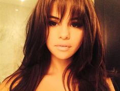 Selena Gomez is bringing back bangs- Love this look! Color is awesome and I have always been able to rock a nice shaggy bang!