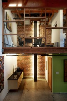 Adaptive reuse of a warehouse for office space by Studio One Eleven Architecture