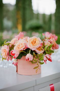 #coral #tulips #flowers Photography: Meg Smith Photography - megsmith.com, Florals by http://kathleendeerydesign.com  Read More: http://stylemepretty.com/2013/10/02/california-coral-wedding-from-meg-smith-photography/