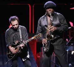 Oct. 2, 2007 The late Clarence Clemons, right, plays tenor alongide Nils Lofgren during a concert in Hartford, Conn.