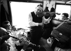 Micha Bar Am - Musicians on a train to Jerusalem, during a holy pilgrimage