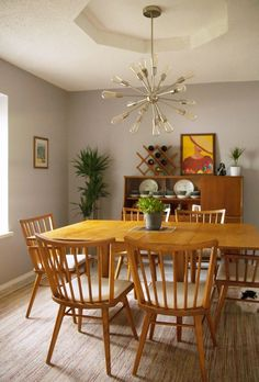 When it comes to decor, sometimes less is more. Refinished furniture and simple, mid-century design touches create the perfect vibe in this dining room space.