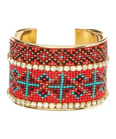 Love the colors and design in this beaded bracelet.