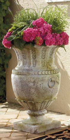 "Standing a grand 30"" tall, this Apian Vessel Outdoor Planter is an imposing garden urn."