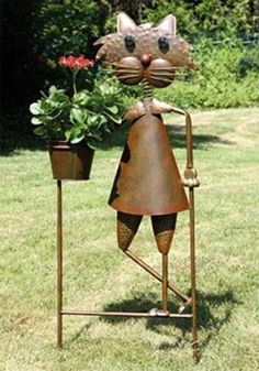 Wrought iron furniture and yard decorations, art work and structures created of metal add beauty and fun to backyard designs and personalize outdoor living spaces in elegant style Modern Backyard Design, Backyard Designs, Modern Landscaping, Patio Design, Fire Pit Globe, Metal Arch, Iron Furniture, Yard Decorations, Metal Lanterns