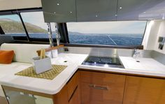 Prestige 450: The galley features a two-burner stove with plenty of counter space to work. And there's certainly no shortage of scenery from this location. Note the cabinets overhead.