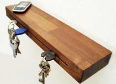 Cool. holds you keys in the slot and your other items on the shelf