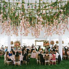 Love the hanging floral design of this wedding reception. Featured Floral design: Holly Heider Chapple Flowers Ltd.