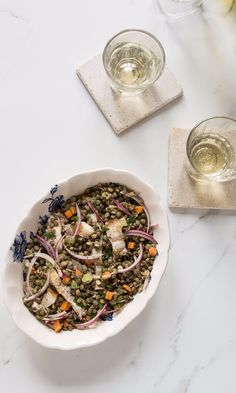 """Chef Daniel Boulud's take on a classic Lyonnaise pairing of pork and lentils. Make sure the lentils are fully cooked , says Boulud, """"otherwise, they don't absorb the seasoning."""" Make sure to taste a few minutes before they are drained: They should be creamy with just a slight bite. #saveurlovesfrance"""