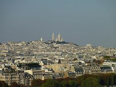 Montmartre is a hill 130 metres high, in the north of Paris in the 18th arrondissement, a part of the Right Bank, primarily known for the white-domed Basilica of the Sacré Cœur on its summit.