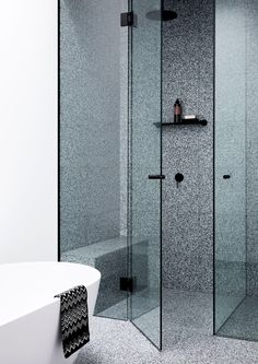 The tinted glass in this monochrome bathroom adds another dimension to what might otherwise be a quite simple space.  I love that the terrazzo is used in the shower and on the floor and is contrasted by pure white elsewhere.  . Design: Studio.Kennon  📷: @caitlinmillsphotography . . . . . #bathroom #bathroomdesign #bathroominspo #brisbane #homerenovation #terrazzo #black #white #monochrome #californiabungalow #renovations #custom #interiors #interiordecor #interiorinspo #interiorstyle