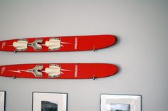 Basement update- hanging waterskis on wall! This is exactly what I want to do with our vintage water skis on a grey wall.