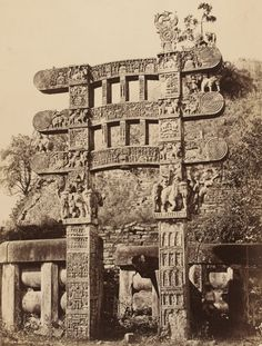 Photograph of Buddhist monuments at Sanchi, India |  Front view of Eastern Gateway, Plate III |  Photograph by James Waterhouse, 1861 |  Albumen print from a wet colloidion negative |  The gateway has two square upright pillars with three architraves, all of which are elaborately carved in relief with scenes from the Buddha's life and stories from the Buddha's previous existences (jatakas). The bottom architrave shows King Asoka and his royal entourage venerating the bodhi tree....
