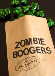 """Zombie Boogers"" Green Candy Coated Popcorn Serves: 8-10, Time: 1 1/2 hrs 3 c popped regular popcorn 1/2 c butter 1 c granulated sugar 1/4 c corn syrup 1/2 tsp salt 1/2 tsp vanilla extract 1/2 tsp green food coloring 1 tsp baking soda Full directions on site."