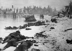 """Sprawled bodies of American soldiers on the beach of Tarawa atoll testify to the ferocity of the battle for this stretch of sand during the U.S. invasion of the Gilbert Islands, in late November 1943. During the 3-day Battle of Tarawa, some 1,000 U.S. Marines died, and another 687 U.S. Navy sailors lost their lives when the USS Liscome Bay was sunk by a Japanese torpedo."""