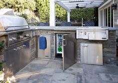Like the gray stone look. Like having a mini fridge integrated in outdoor space.