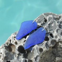 Sea glass earrings with very rare large pieces of cobalt blue sea glass that was found on the beaches of Rincon, Puerto Rico.