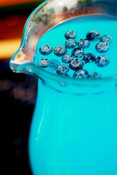 Blue lemonade with frozen blueberries. Very refreshing and goes beautiful in a nautical themed party.