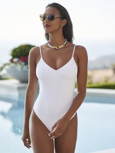 Suit up for summer. Our favorite collection of swimsuits to pack for paradise. Shop one-pieces, bikinis, rash guards and cover ups in our Swim Shop. Swimsuits, Bikinis, Swimwear, Us Swimming, Swim Shop, Summer Essentials, Rash Guard, Resort Wear, Poster