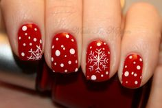 Cute red and white snowflake nails.
