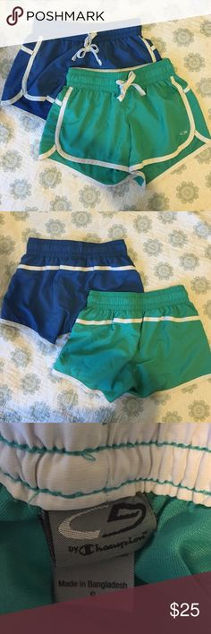 THREE Running Shorts Bundle THREE pairs of super comfy running shorts! One pair is a pretty royal blue, one is a green/aqua color, and one is a bright pink. All pairs have only been worn 1-2 times and are in excellent condition! 100% polyester. AMAZING deal! Champion Shorts