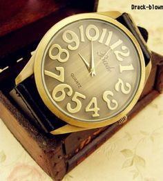 Retro Big Dail Genuine Leather Watch Details Product Name:Retro Big Dail Genuine Leather Watch color:dark green/wine red/black/ dark or light brown/blue  size (in cm) belt 27*21 face 4.3  material: Genuine leather  look after me: Avoid contact with liquids