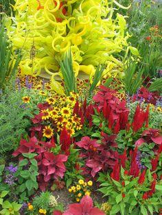 Dale Chihuly installation, at Frederik Meijer Gardens & Sculpture Park, Grand Rapids, Michigan. A riot of color. Blown Glass Art, Art Of Glass, Glass Vase, Dale Chihuly, Glass Garden, Garden Art, Garden Whimsy, Garden Junk, Garden Sheds