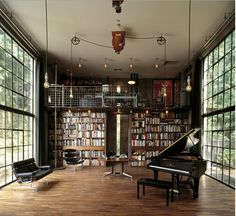 Love the industrial-ness of this room with the piano