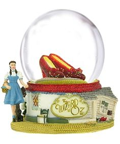 "The Wizard of Oz  Ruby Slippers Snow Globe     ""Then close your eyes, and tap your heels together three times...And think to yourself -- 'There's no place like home...'"" America and the world fell in love with these words and the timeless tale of good versus evil in The Wizard of Oz."