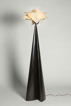 La Religieuse floor lamp, 1923, designed by Pierre Chareau. Centre Pompidou, Musée National d'Art Moderne, Centre de Creation Industrielle, Paris, Purchase funded in part by the Scaler Foundation, 1995. Photograph by Ken Collins, image provided by Gallery Vallois America, LLC