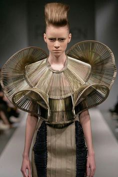 Architectural Fashion - 3D construct with complex line and curve structure; wearable sculpture