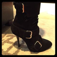 Guiseppe Zanotti suede 3 buckle high ankle boots Guiseppe Zanotti gorgeous lightly worn high heel black ankle boots. Zipper for easy access and Laces included too with three belt buckle details! These are divine!!!! Belonged to my fashionable sister and I can't keep pretending I can put my size 9-10 foot in them!! Want to find them a good home. They are so sick!!!! Guiseppe Zanotti Shoes Ankle Boots & Booties