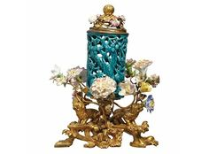 Louis XV Gilt-Bronze Mounted Turquoise Glazed Floral Encrusted Porcelain Potpourris  Estimate: USD 4,000 - 6,000