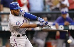 Texas Rangers' Elvis Andrus shatters his bat as he grounds out in the ninth inning against the Seattle Mariners to end a baseball game Saturday, July 14, 2012, in Seattle. The Mariners won 7-0. (AP Photo/Elaine Thompson)