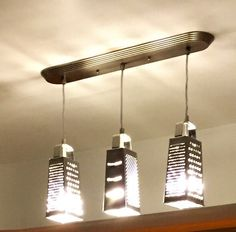 Industrial Lighting - Grater Chandelier - Modern  Ceiling Light - Industrial Chandelier by IWantThattt on Etsy https://www.etsy.com/listing/215485446/industrial-lighting-grater-chandelier