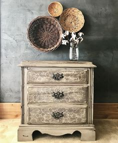 Painted in French Linen, pallet wood top and papered drawers!